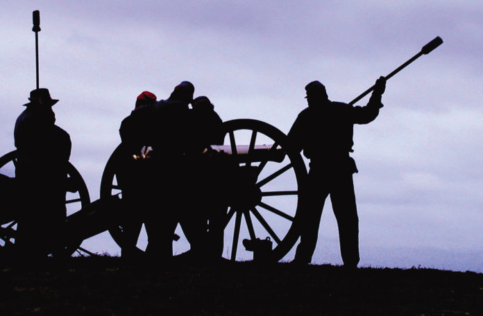 Civil War reenactors recreate a cannon battle