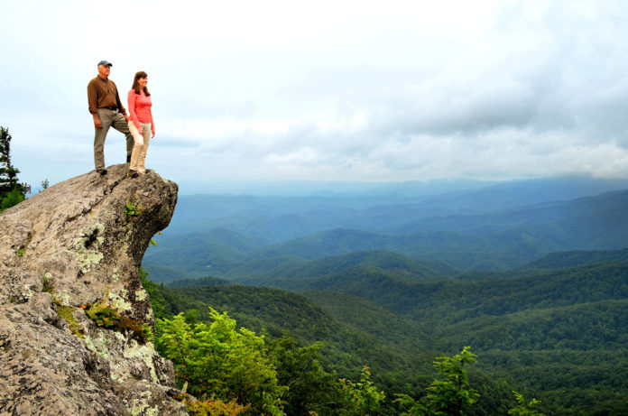 Visitors atop The Blowing Rock