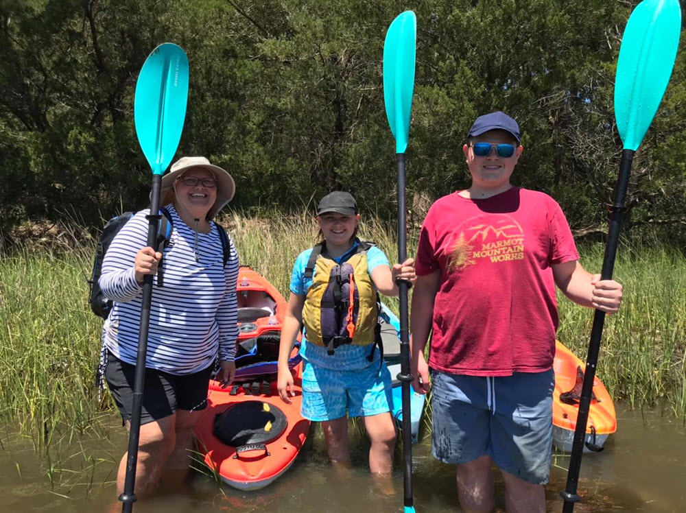 Family kayaks to find fossilized shark teeth