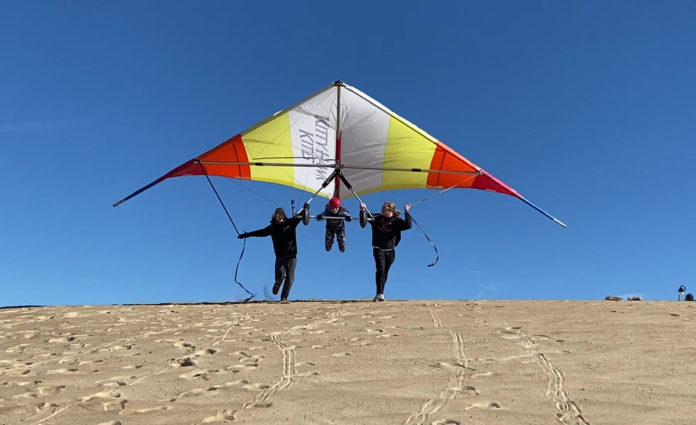 Student takes flight on a hang gliding lesson in the Outer Banks